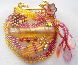 Broach designed around a Jonathan Winter lampwork bead